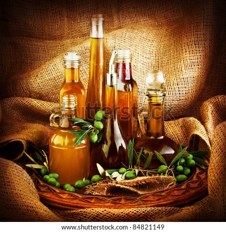 Different salad dressings, olive oils, vinegars, seasoning, condiment, sauces, sauces, dips..etc. dark still life with canvas