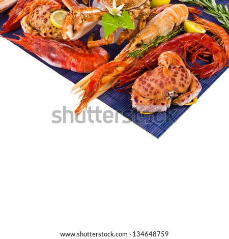 different sea food shrimp and crabs for a blue mat isolated on white background  with sample text - stock photo