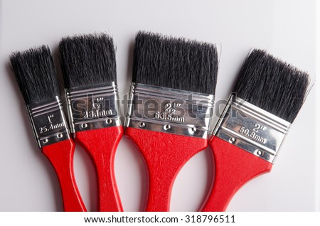 Different size of paint brushes for using in decoration. - stock photo
