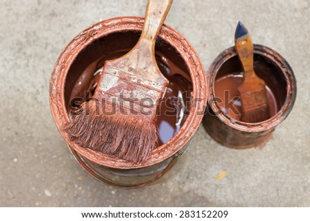 Different size of paintbrushes and wood preservation