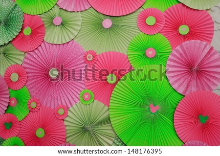 different sizes and colors bright Japanese umbrellas - stock photo