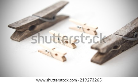 Different sizes clothespin macro still on an isolated white background. - stock photo