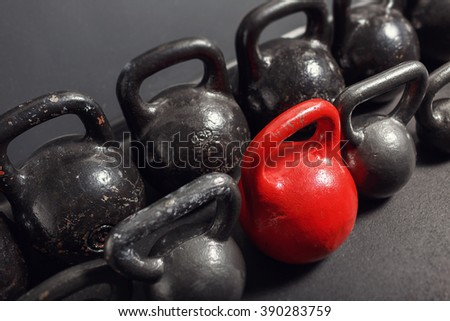 Different sizes of kettlebells lying on gym. Equipment for training at fitness club - stock photo