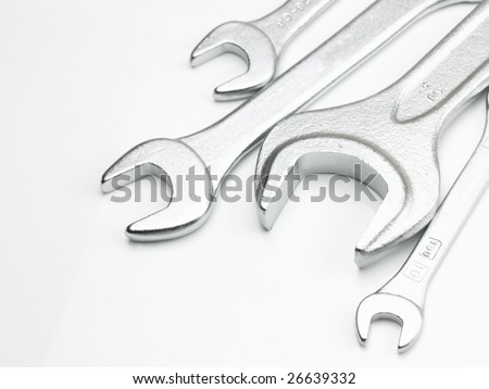 Different sizes of metal wrench in white background