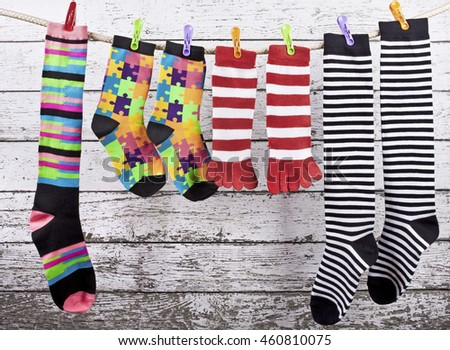 Different socks hanging on the rope - stock photo