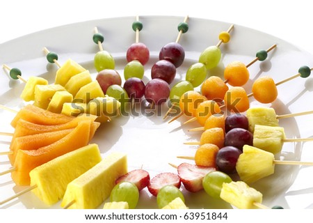 Different sort of fruit canape for a self service buffet - stock photo