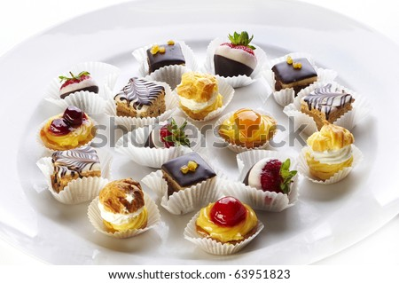 Different sort of small home made sweet cakes - stock photo