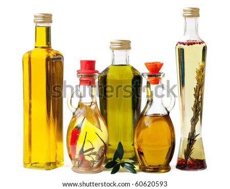 Different sorts of cooking oil isolated on white background - stock photo