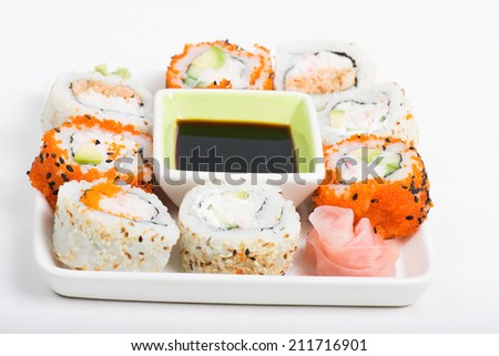 Different sorts of sushi on the plate - stock photo