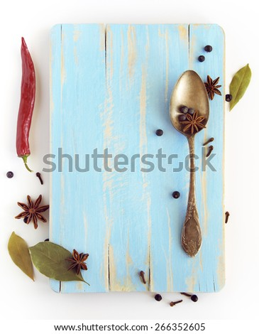 Different spices, anise, laurel, clove and others on a wooden board - stock photo