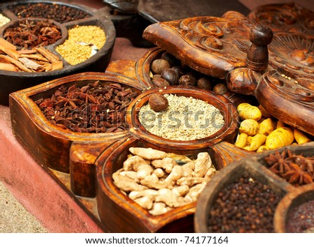 Different spices in handmade wooden box - stock photo