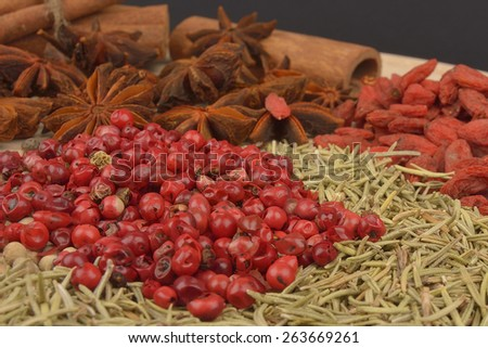 different spices on wooden background. close up - stock photo
