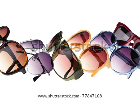 Different styles of tinted sunglasses on white background - stock photo