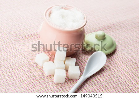 Different sugar on pink background. Selective focus. - stock photo