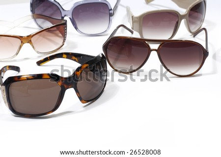 Different sunglasses on white - stock photo