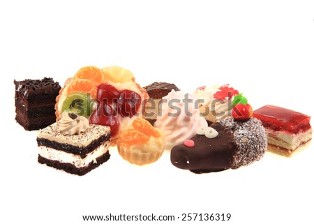 different sweet desserts isolated on the white background - stock photo