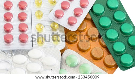 Different tablets of different colors on a white background