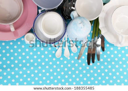 Different tableware on tablecloth - stock photo