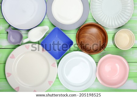 Different tableware on wooden background - stock photo