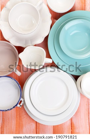 Different tableware on wooden table - stock photo