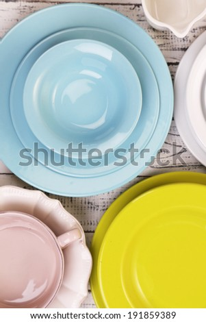 Different tableware on wooden table
