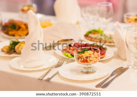 Different tasty snacks for wine on luxury banquet table - stock photo