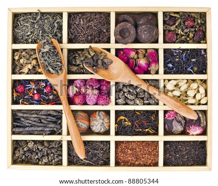 different tea types : green, black, floral , herbal in a box isolated on white background - stock photo