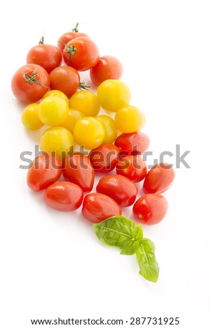 Different tomatoes on white background