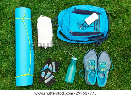 Different tools and accessories for sport. Fitness concept - stock photo