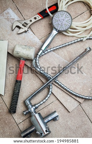 different tools for renovation in the bathroom - stock photo