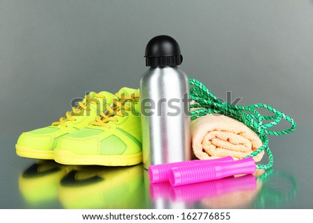 Different tools for sport on grey background