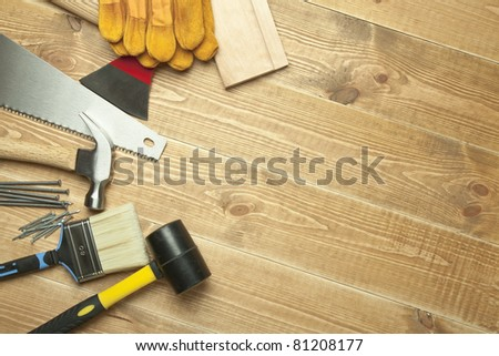 Different tools on a wooden background. - stock photo