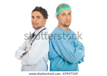 Different two doctors men standing back to back with arms folded and looking at camera isolated on white background