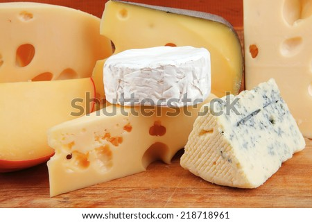 different type of cheese served on wood - stock photo
