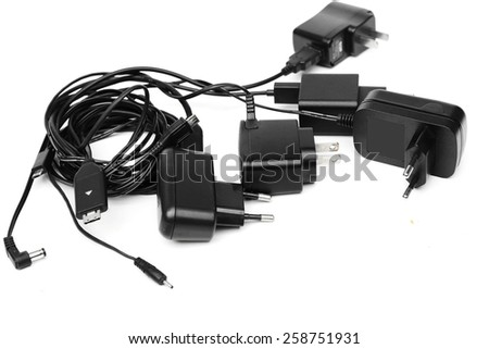 Different types of adapter charger on isolated background                                - stock photo