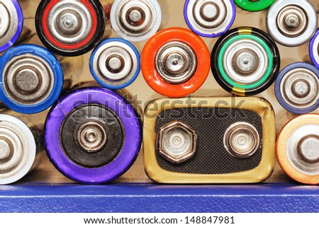 Different types of batteries arranged in a stack - stock photo