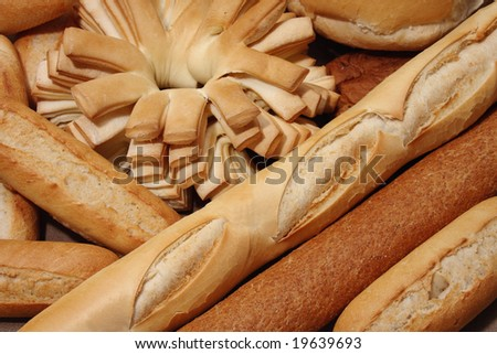 Different types of bread background. Focus on baguette.