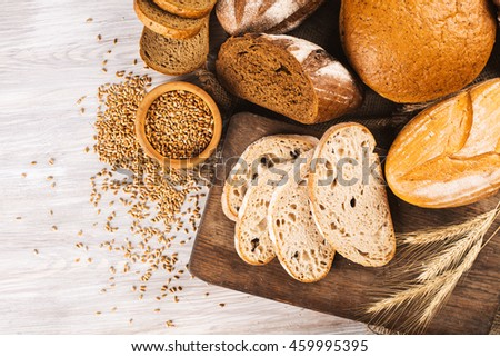 Different types of bread on a wooden background
