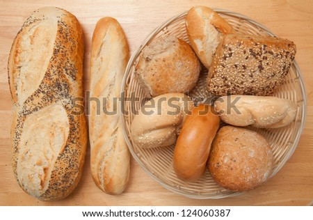 Different types of bread on the table and the basket