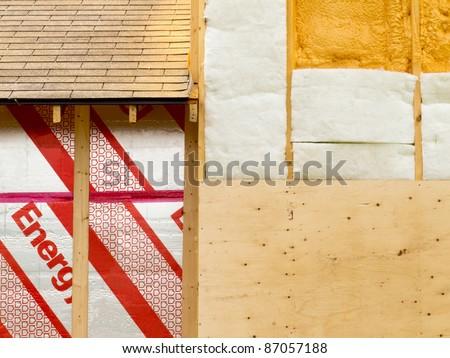 Different types of building insulation: rigid extruded foam sheets, polyurethane spray foam and fiberglass mats. - stock photo