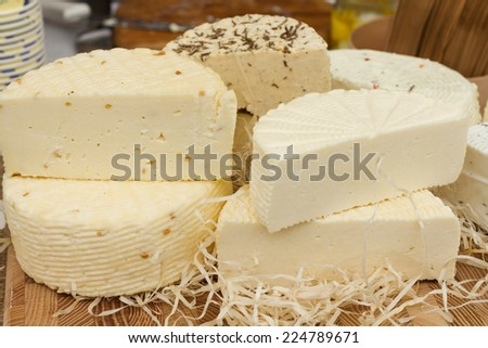 Different types of cheese on the table - stock photo