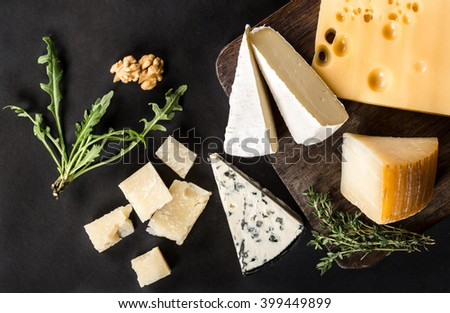 Different types of cheeses on black