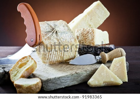 different types of cheeses on cutting board old - stock photo