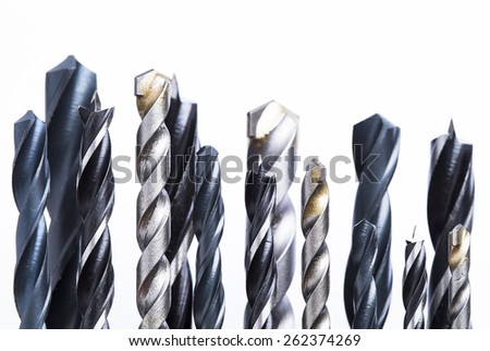 Different types of drill bits isolated on white background - stock photo