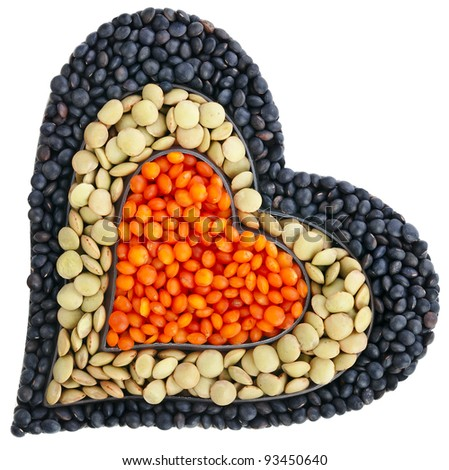 different types of grains of lentils in the form of heart , isolated on white background - stock photo
