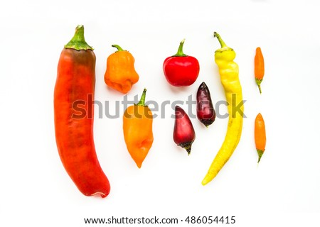 different types of hot peppers on a white background, isolates, different content capsaicin