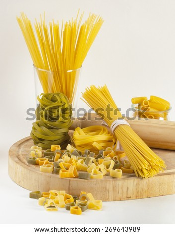 Different types of Italian pasta on a cutting board.