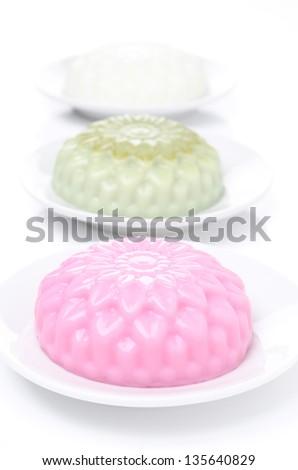 different types of Panna cotta (raspberry, tea matcha, vanilla) vertical - stock photo