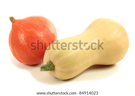Different types of pumpkins on a white table. - stock photo
