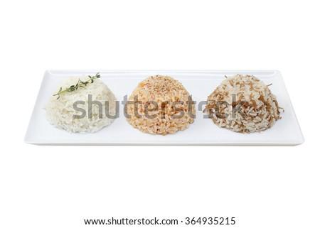 different types of rice : brown rice, wild rice and white (jasmine) - stock photo